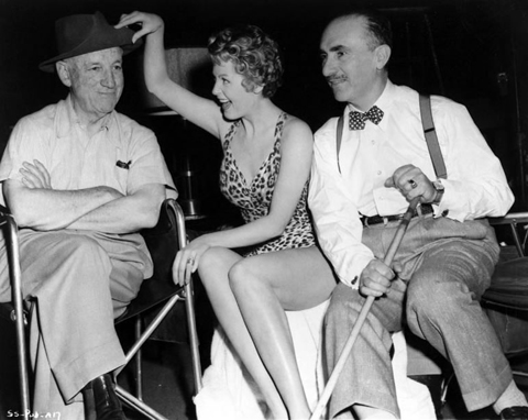"Director Allan Dwan, Arlene Dahl, John Alton on set of color noir feature ""Slightly Scarlet,"" 1956."