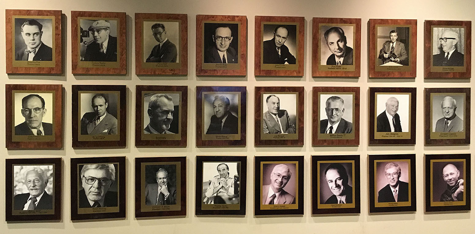 A portion of the wall of portraits of ASC presidents.