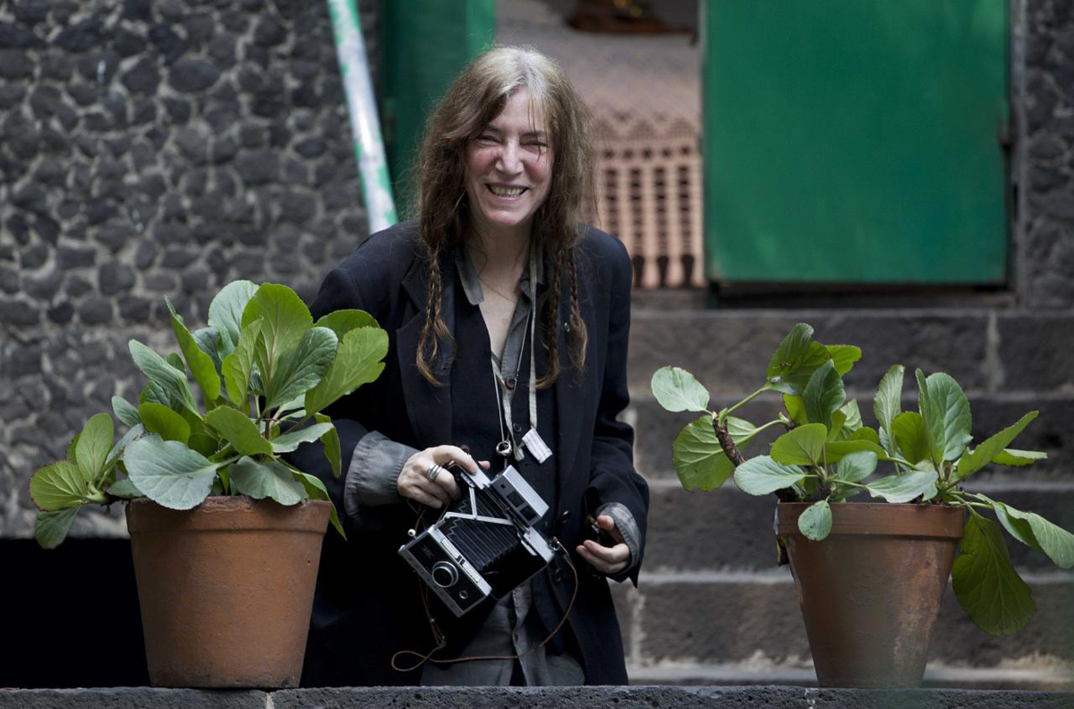 Singer Patti Smith with her Polaroid (Credit: Eduardo Verdugo)