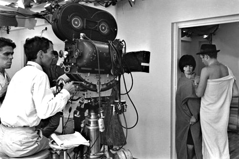 Godard at BNC, cinematographer Raoul Coutard at extreme left.