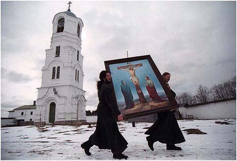 Two monks carrying an icon, Aleksando, Svirsky monastery.