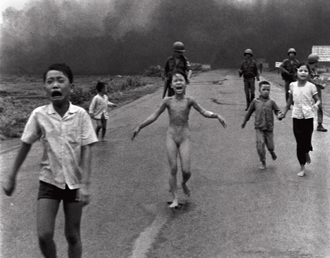 Phan Thj Kim Phuc, running toward camera, by Nick Ut.