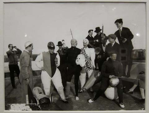 "Cast and crew photo for ""Triadic Ballet."" Schlemmer in center, in black, holding doll's head."