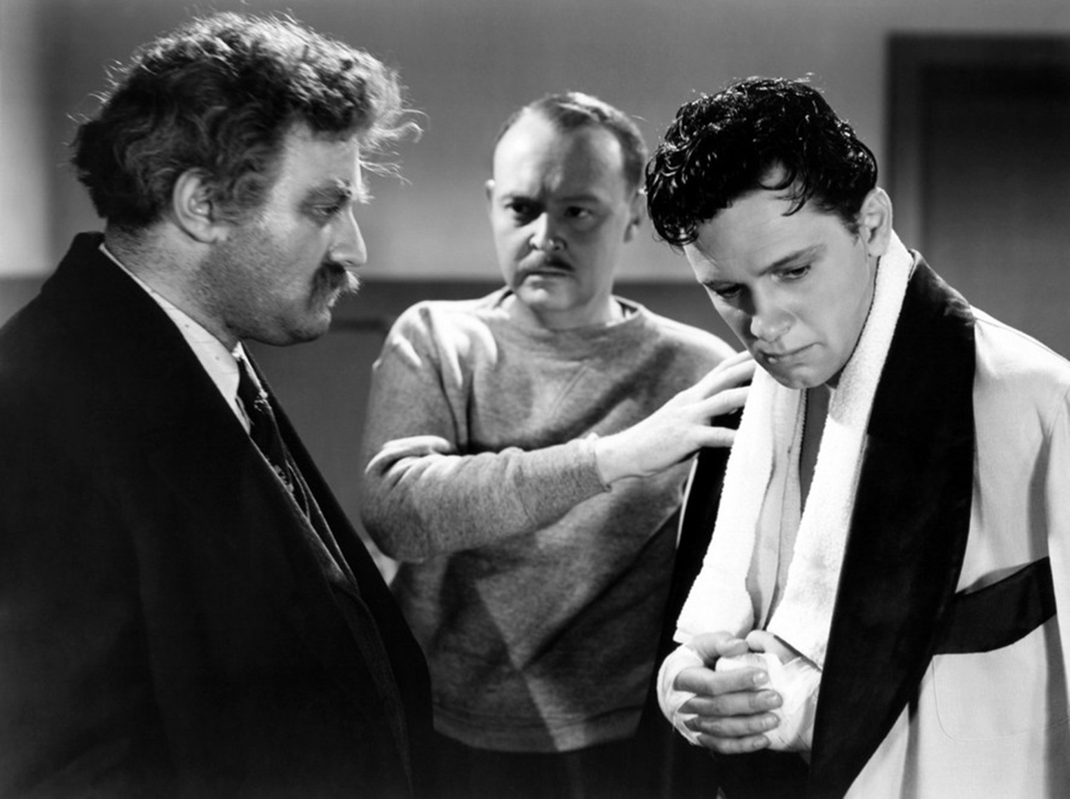 From left: Lee J. Cobb, Don Beddoe and William Holden in Golden Boy.