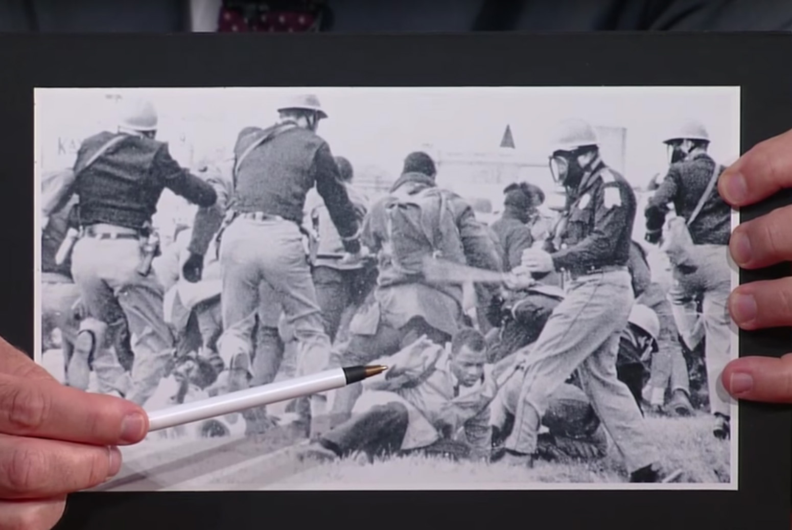 "Colbert points to Lewis in an archival photo of ""Bloody Sunday."""