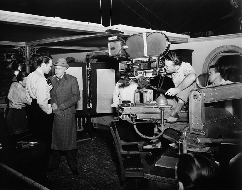 Cinematographer Gregg Toland films Orson Welles and TK for Citizen Kane (1941). (Credit: Margaret Herrick Library)