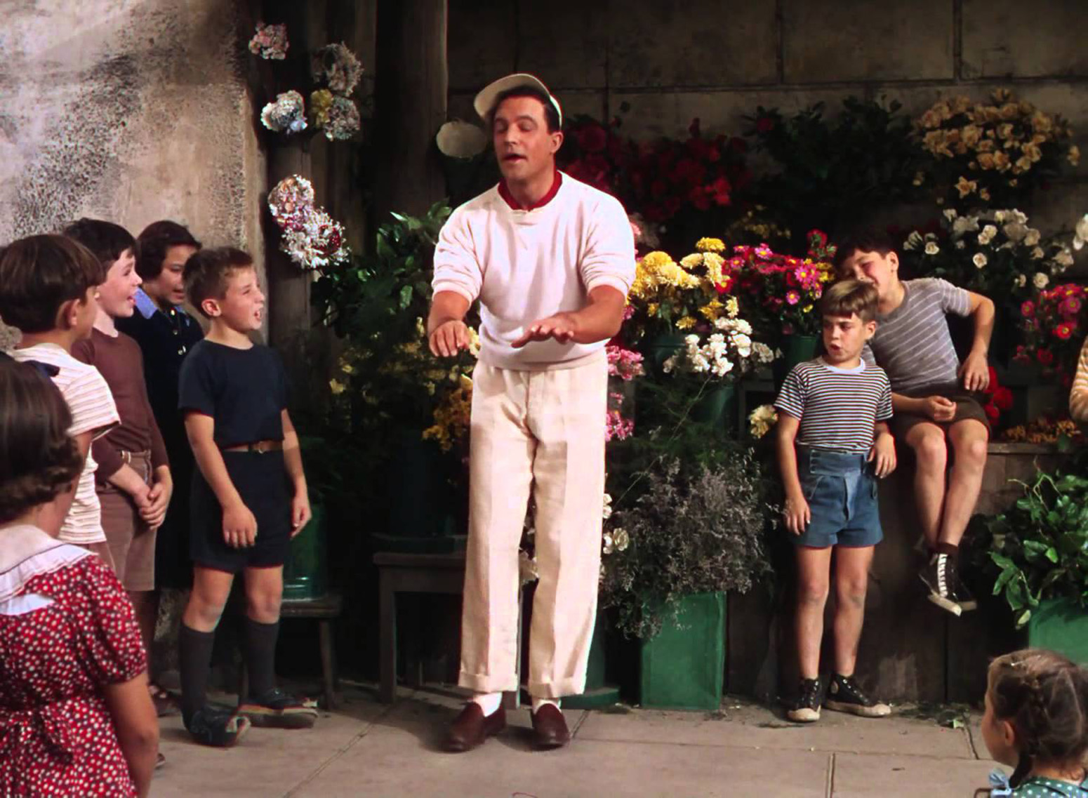 "Gene Kelly and friends in the number ""I Got Rhythm,"" lit by Gilks."