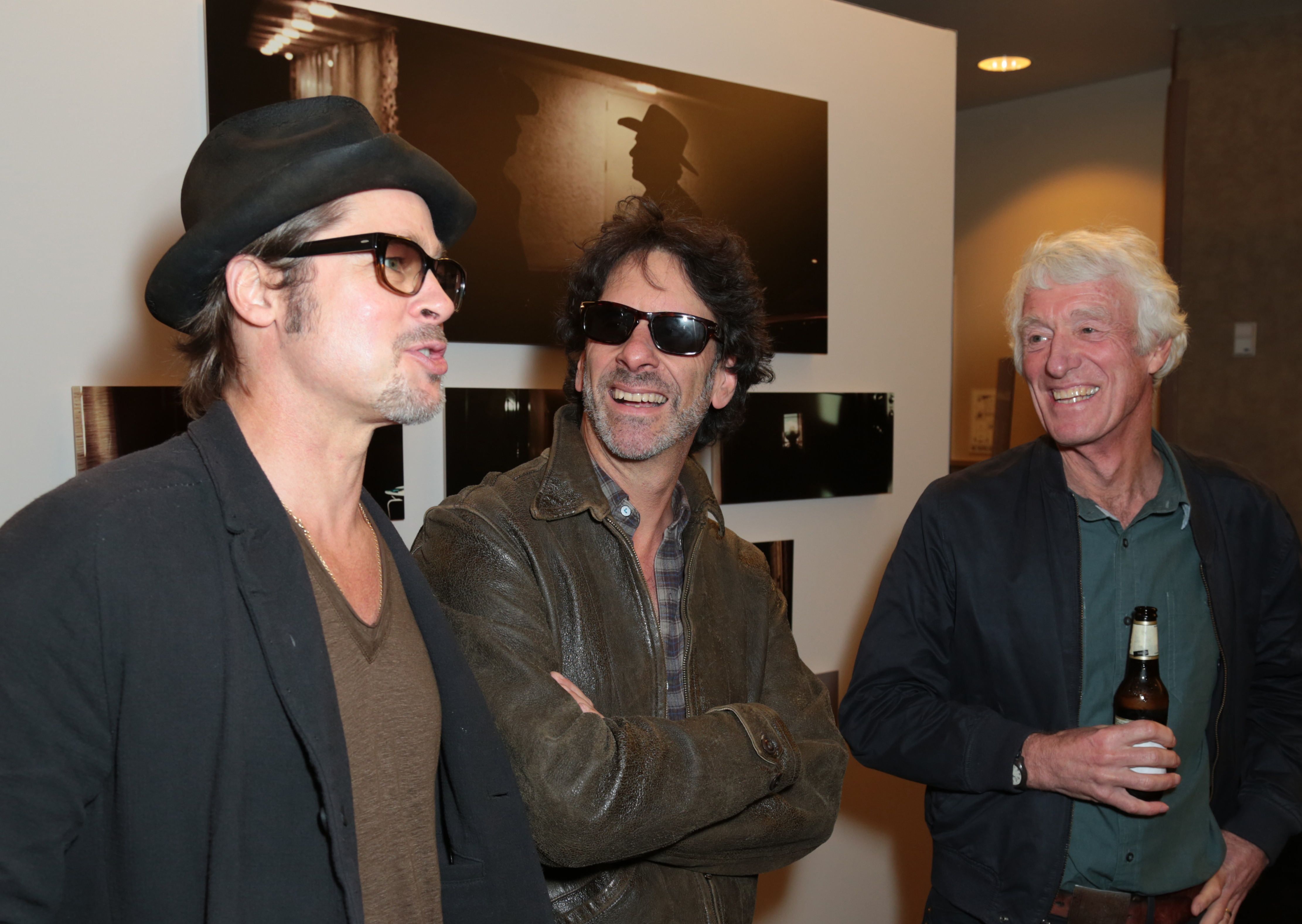 From left: Brad Pitt, Joel Coen and Roger Deakins mingle at the opening reception for Roger Deakins: Persistent Vision.
