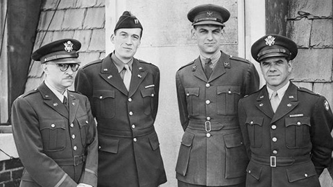 John Huston (second from left) and Frank Capra (right), London, August 1943.