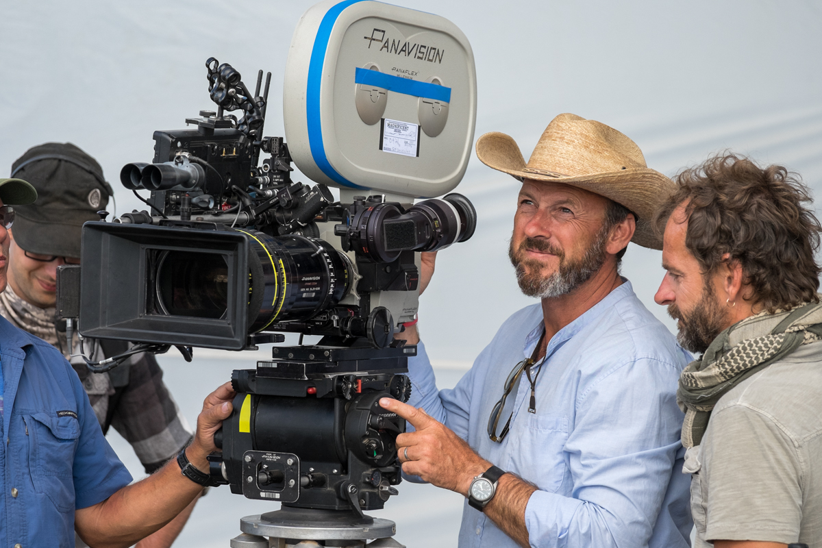 Mauro Fiore, ASC (center) and crew on the set of The Magnificent Seven.
