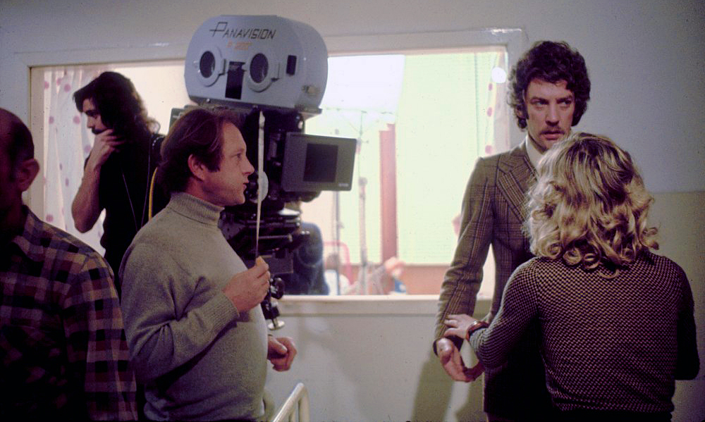 On the set of Don't Look Now (1973) are (from left) cinematographer Tony Richmond, director Nicholas Roeg and actors Donald Sutherland and Julie Christie.