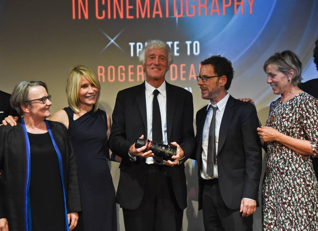 Posing at the ceremony honoring Roger Deakins, ASC, BSC, are (from left): director Agnieszka Holland, James and Roger Deakins, director Ethan Coen and actor Frances McDormand. (Credit: Angenieux/Pauline Maillet)