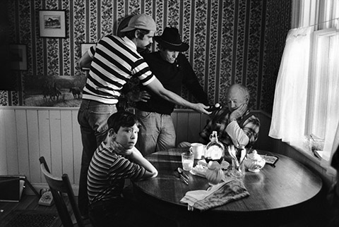 At work on THE BLACK STALLION, cinematographer Caleb Deschanel (left) and director Carroll Ballard prep a scene with actors Mickey Rooney and Kelly Reno.