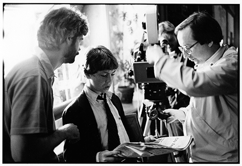 At work on THE ESCAPE ARTIST, director Caleb Deschanel (left) and cinematographer Stephen Burum (right) work out a setup with young star Griffin O'Neal.