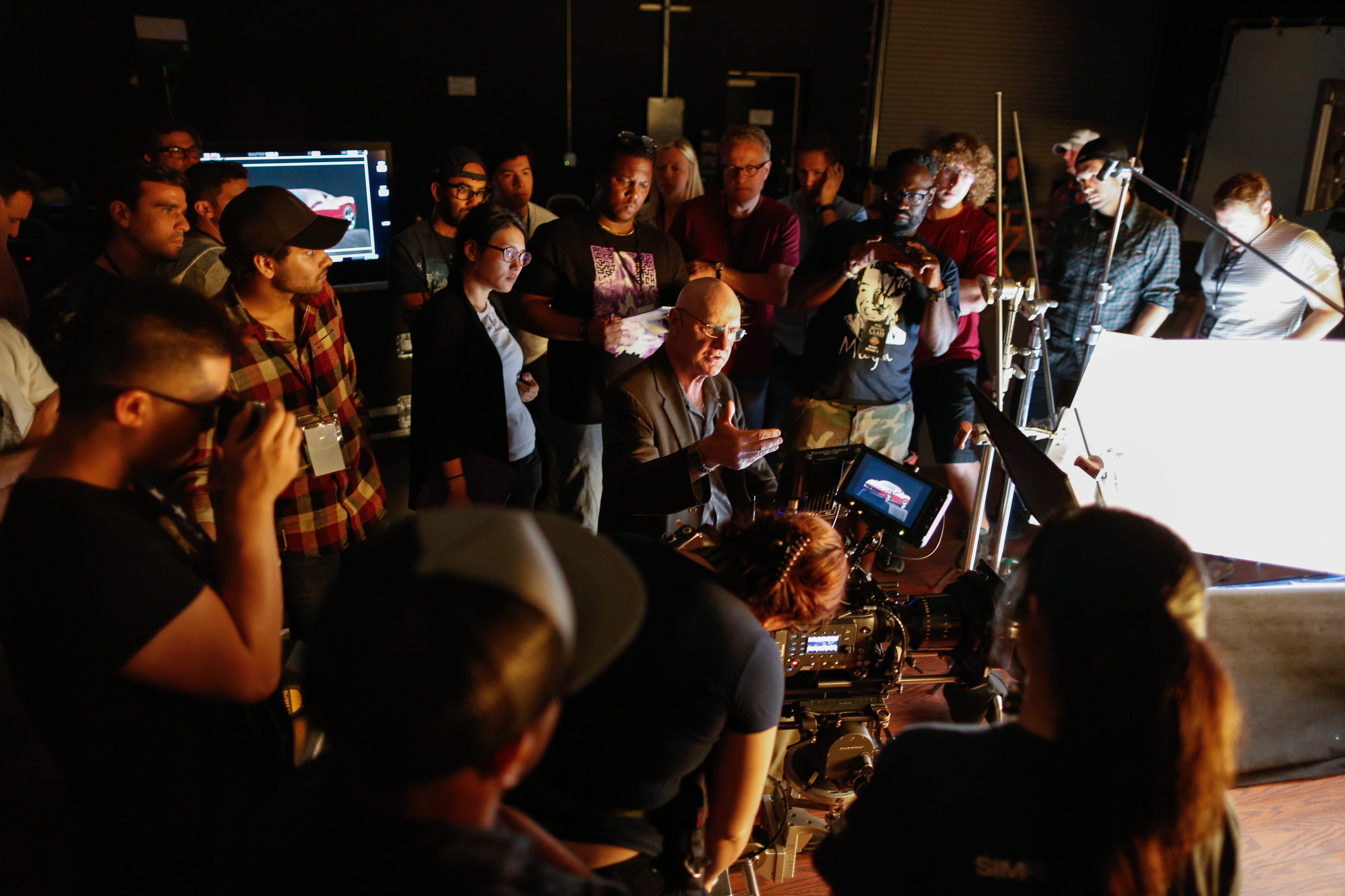 Bill Bennett, ASC lectures on the set of commercial photography.