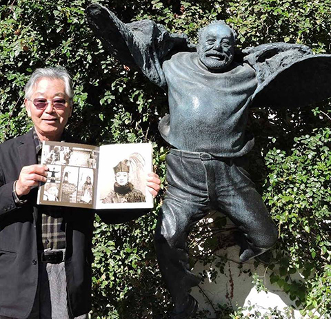 Narita with Parajanov's statue and Sofiko Chiaureli's book.