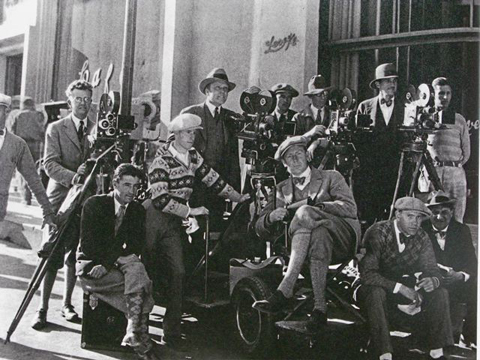 Four cameras: Murnau at center right, legs crossed, below Rosher's camera, Struss at camera on left.