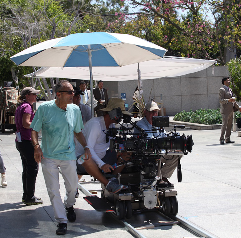 Makris (left, wearing green shirt) directs an episode of Secrets and Lies.