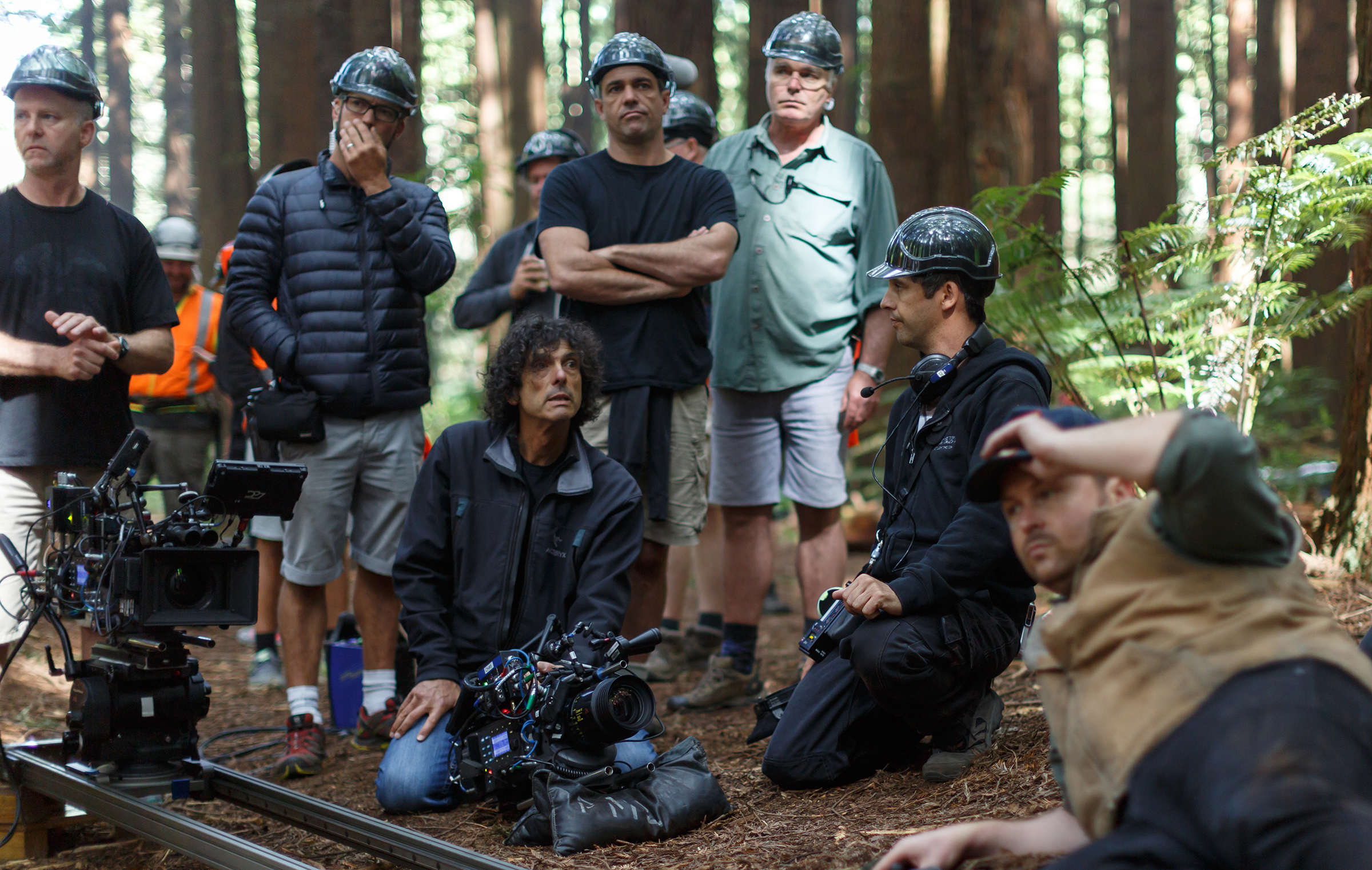 Director David Lowery and cinematographer Bojan Bazelli, ASC (kneeling) on the set of Disney's Pete's Dragon.