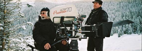 Robert Richardson, ASC (left), and 1st AC Gregor Tavenner at work on The Hateful Eight. (Credit: Panavision)