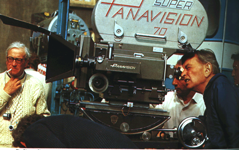 "On location in Ireland for ""Ryan's Daughter"" Director David Lean checks the camera angle through the viewfinder, while Director of Photography Freddie Young, BSC (left) looks on."