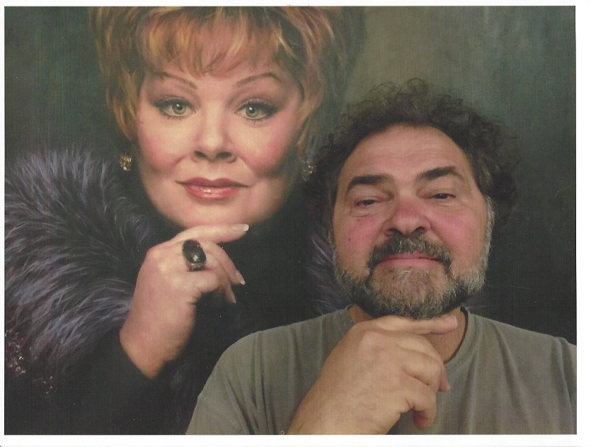 Julio Macat poses next to a mural painting of Melissa McCarthy on the set for The Boss, his latest comedy.