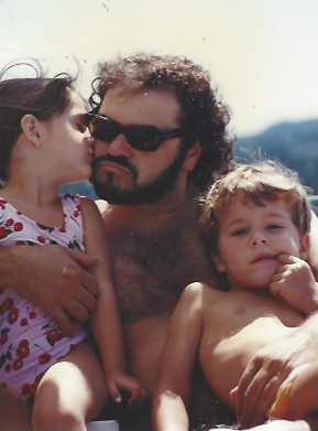 In this photo taken 20 years ago, Julio Macat poses with his step-daughter Hannah and his son Alex.