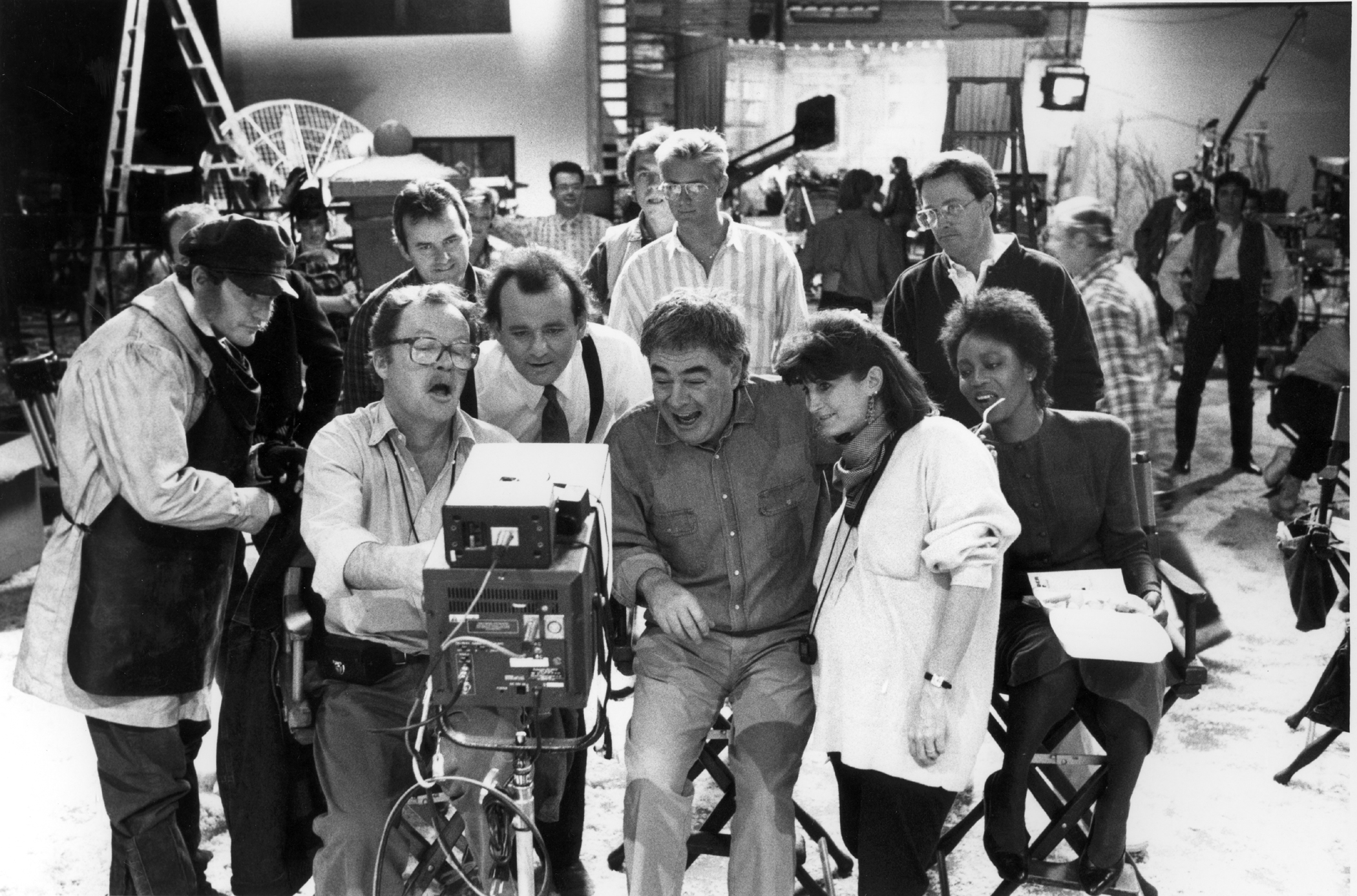 While filming the comedy Scrooged (1988), with star Bill Murray and director Richard Donner.