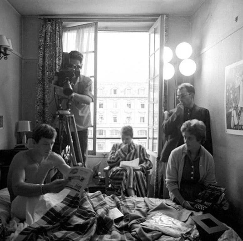 Shooting the hotel room interior of Breathless. Left to right: Jean-Paul Belmondo, Coutard behind Eclair Cameflex, Jean Seberg, Jean-Luc Godard and script Suzanne Faye (photo by Raymond Cauchetier)