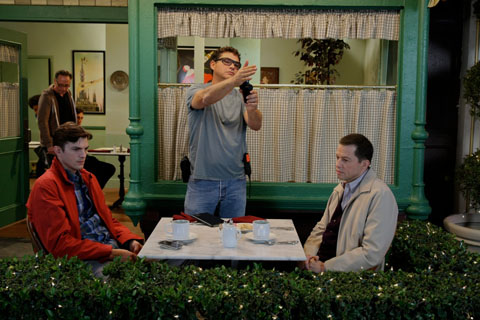 Steve checks the light as Jon Cryer and Ashton Kucher ready for a scene in TWO AND A HALF MEN.