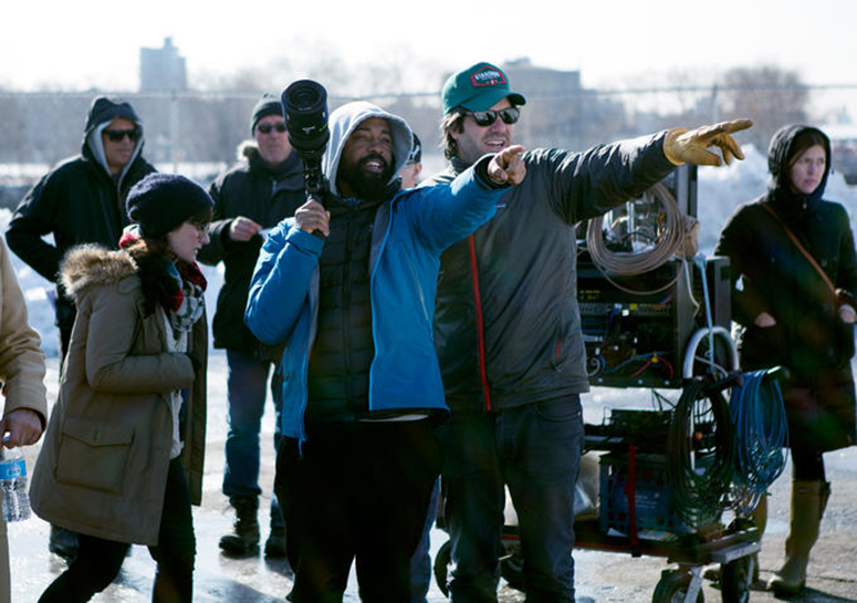 Cinematographer Bradford Young (left) and director J.C. Chandor on location for A Most Violent Year. (Credit: Atsushi Nishijima/A24)
