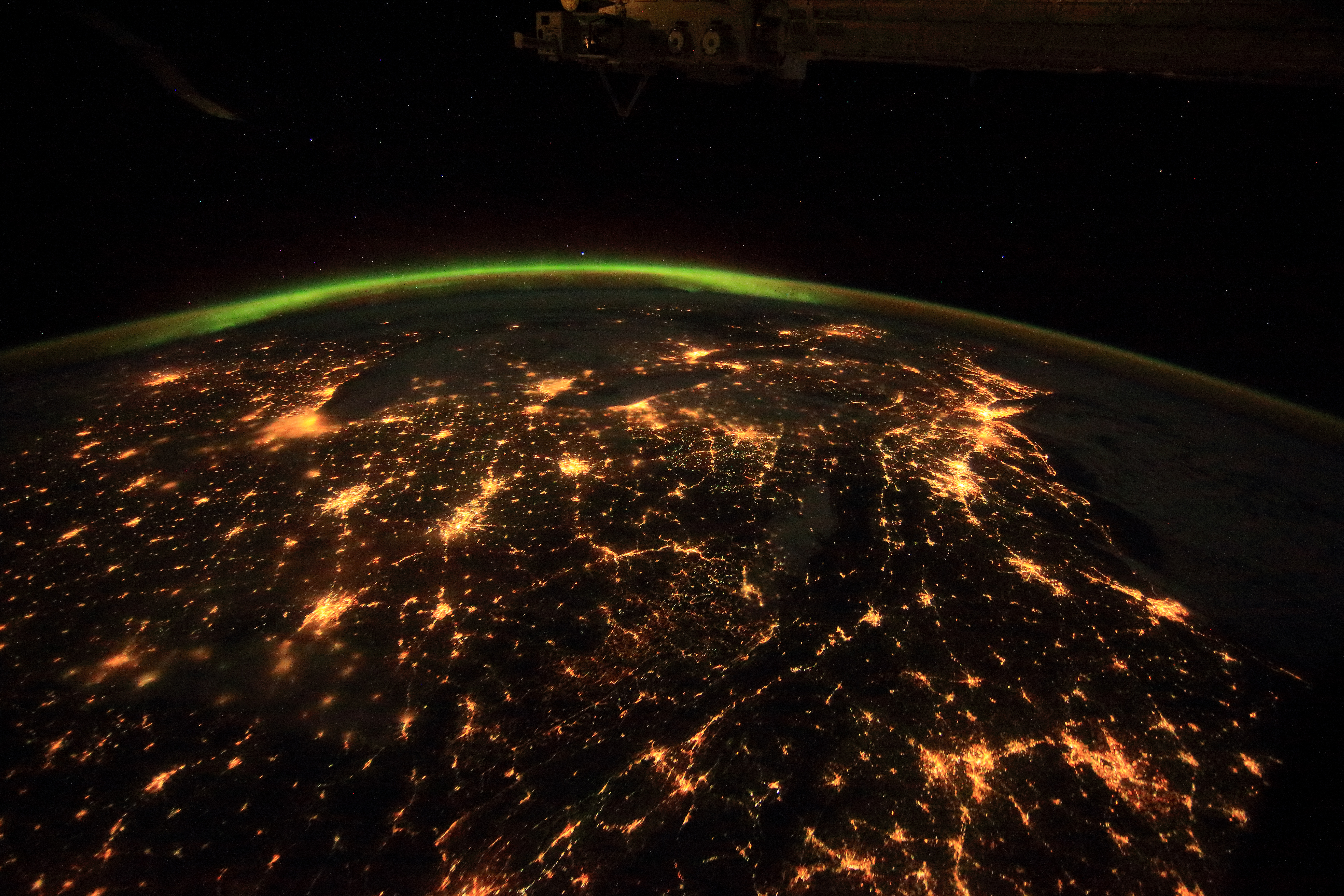 A nocturnal view of city lights from aboard the ISS, as seen in the IMAX film A Beautiful Planet.