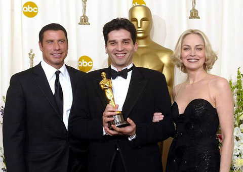 "Danis Tanovic, flanked by John Travolta and Sharon Stone with his Oscar for ""No Man's Land,"" 2001."