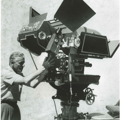 1957. The first 65mm Panavision camera used on Ben-Hur. The camera assistant is mounting an Anamorphic APO Panatar designed for Ultra Panavision 70 (aka MGM Camera 65) (credit Panavision)