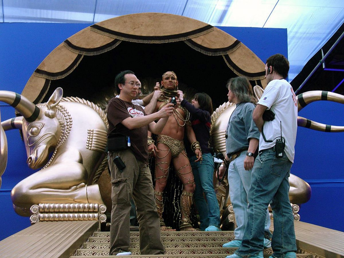 Fong checks his light as the team touches up the elaborate costume for actor Rodrigo Santoro, playing the ruthless, god-like Persian leader. (Photo by Jim Bissell)