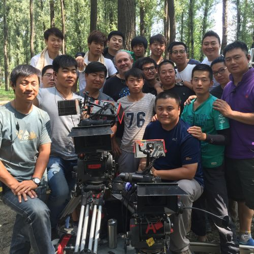 Chris Chomyn, ASC, poses with crew on location in China for <em>The Three-Body Problem</em>.