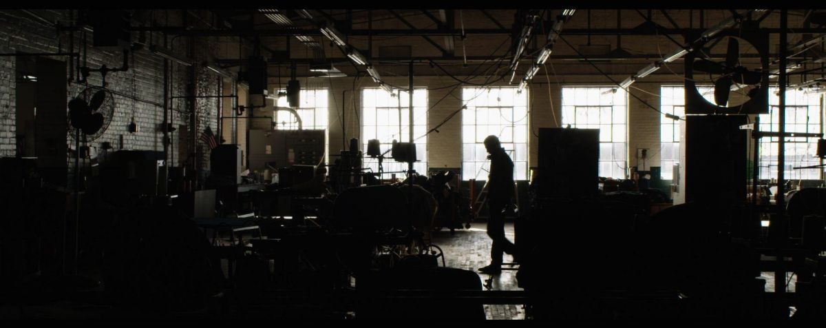 Actor Ryan O'Quinn walks through the deserted warehouse set.