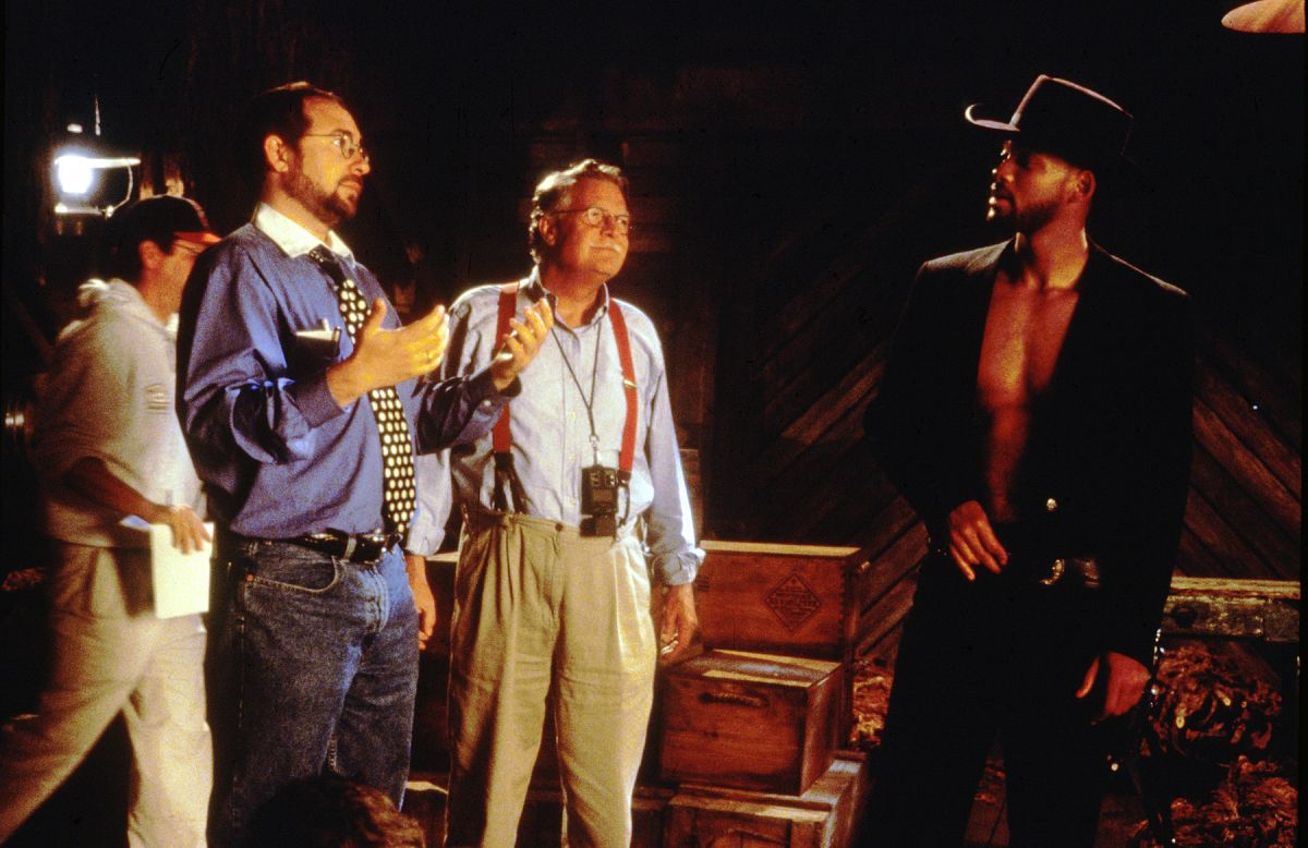 Ballhaus listens as cinematographer-turned-director Barry Sonnenfeld offers suggestions to actor Will Smith on the set of the 1999 comedy Wild Wild West.