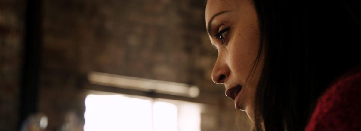 An evocative close-up on actress Danielle Nicolet, playing the role of Sharon.