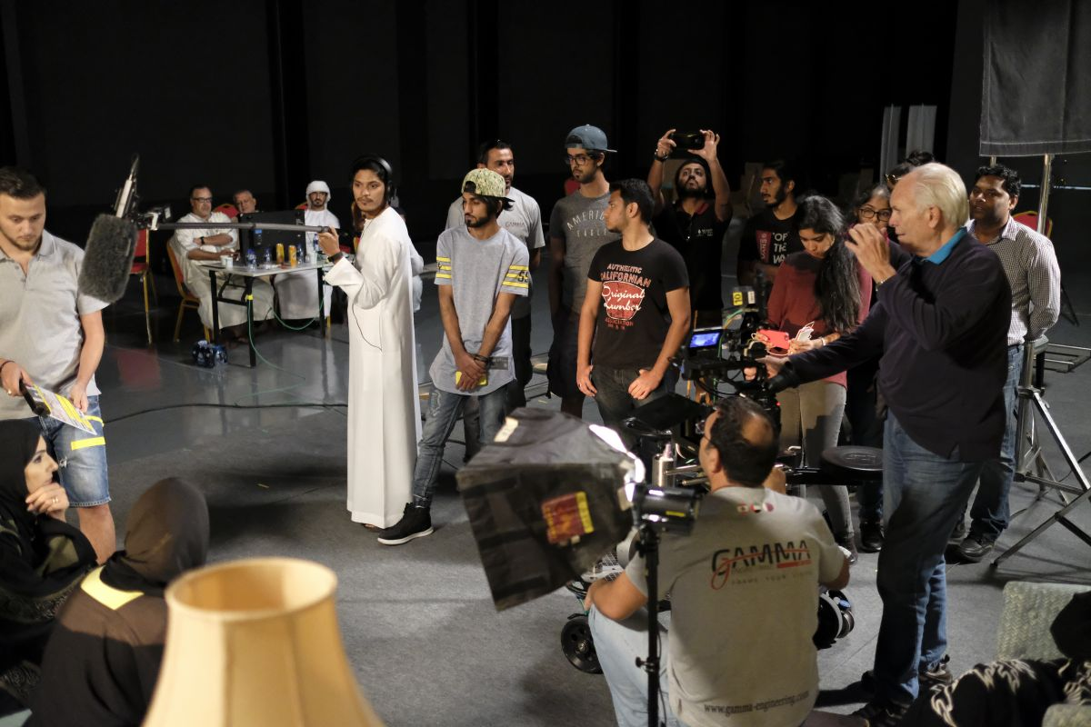 "Shaw leads his class in constructing a scene. ""One of the students in class had written a script and we built a set — much like what is done for the ASC Master Class sessions — and blocked out the action with five actors, lit it with the students, and set the shots,"" he describes. ""The key thing is that we got the class out of their seats and in the set. You learn best by doing."" In the background are key event organizers, standing in as ""executive producers."""