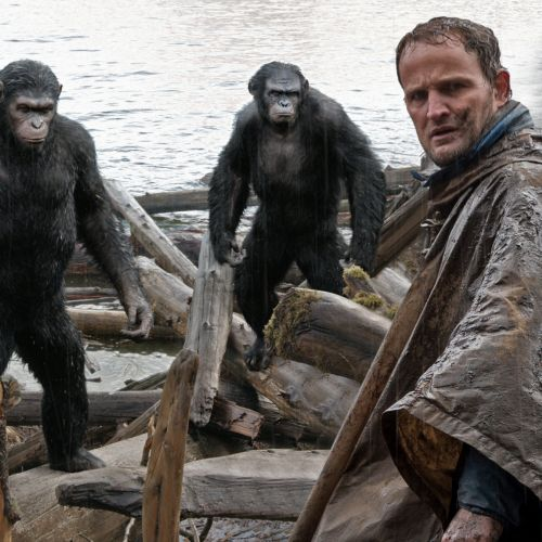 Malcolm (Jason Clarke, foreground) tries to make peace with Caesar (Andy Serkis, left), Koba (Toby Kebbell) and Maurice (Karin Konoval).