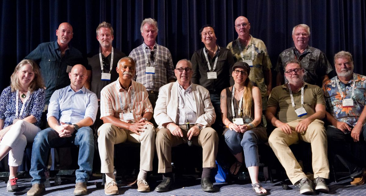 "This all-star team of Society members held a ""Dialogue with ASC Cinematographers"" session at Cine Gear Expo in 2016 at the Sherry Lansing Theater on the Paramount Studios lot. They were (top row, from left) Daniel Pearl, David Perkal, Chuck Minsky, Michael Goi, Bill Bennett, James Neihouse, Dean Cundey, Guillermo Navarro, Lisa Weigand, moderator George Spiro Dibie, Donald A. Morgan, Dave Klein and Cynthia Pusheck. Photo by George Leon."