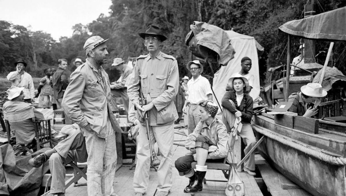 On location shooting The African Queen (1951).