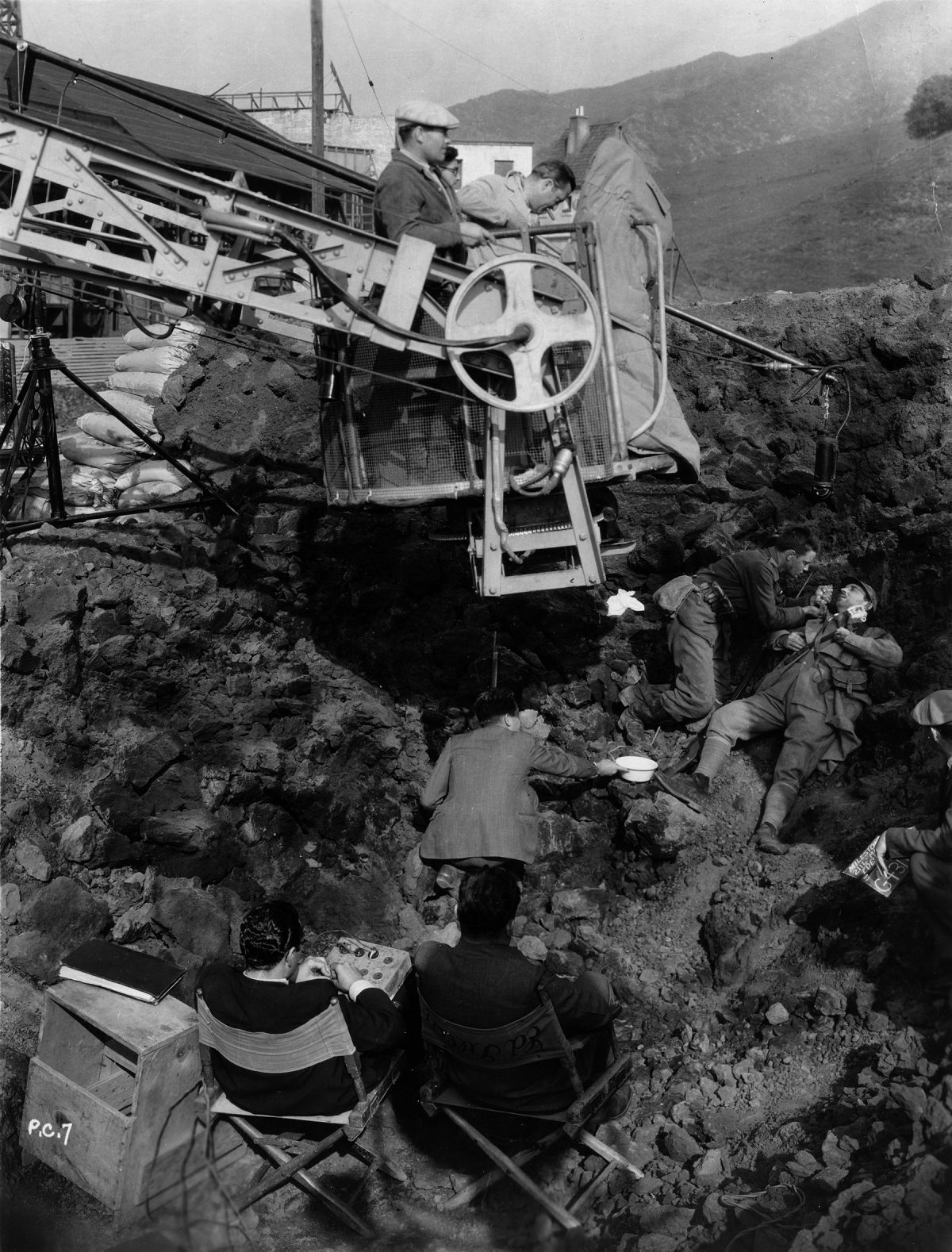 Angling in on a crane, Arthur Edeson, ASC behind the camera.