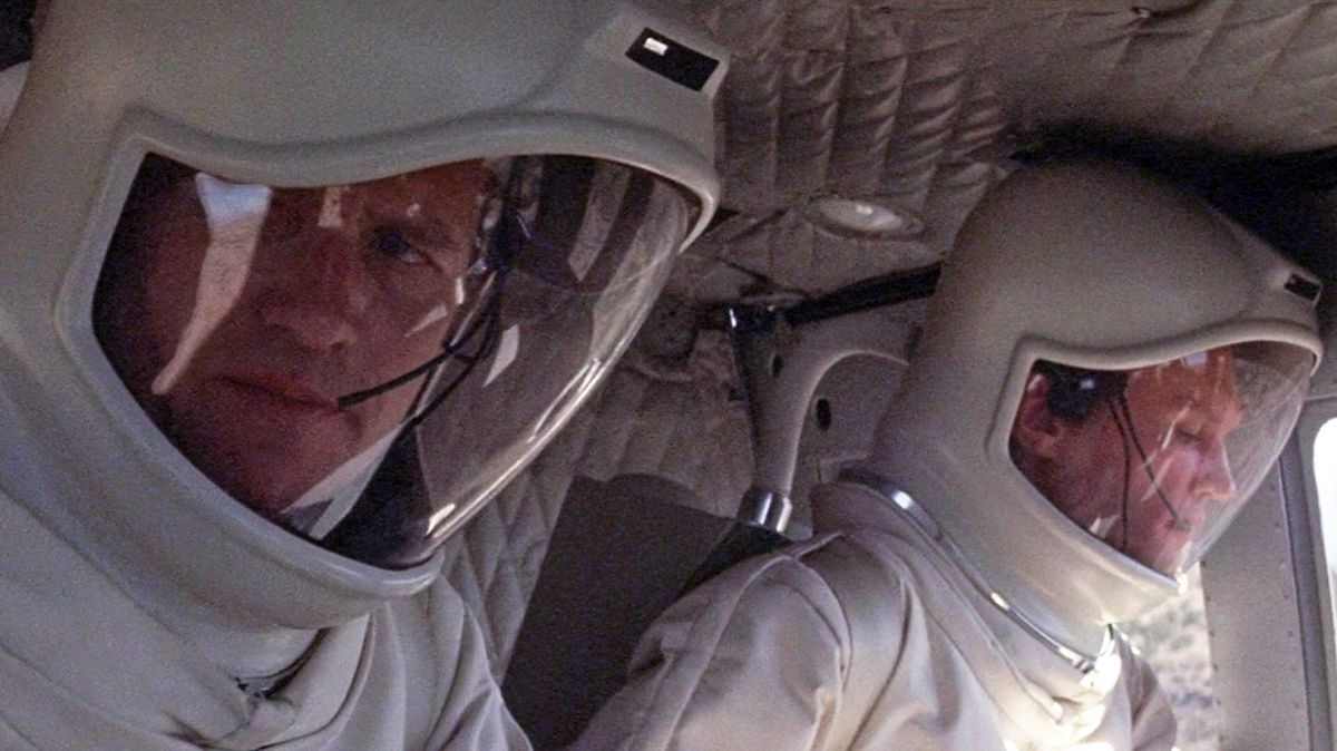 Arriving by helicopter in haz-mat gear, scientists Dr. Jeremy Stone (Arthur Hill) and Dr. Mark Hall (James Olson) lead the investigation on the ground in the remote New Mexican village first affected by the alien organism.