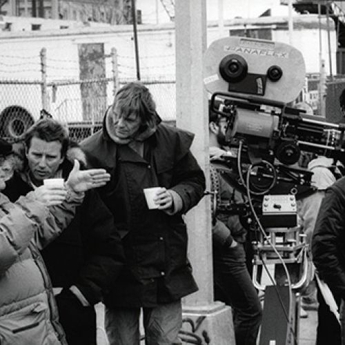 Director Alan Parker (left) works out a setup with cinematographer Michael Seresin, BSC (next to Parker), and camera operator Mike Roberts. Standing in front of the camera is 1st AC Eamon O'Keefe.