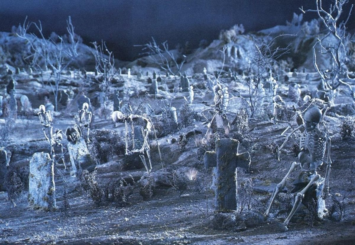 A closeup look at the miniature graveyard with its busy skeletons.