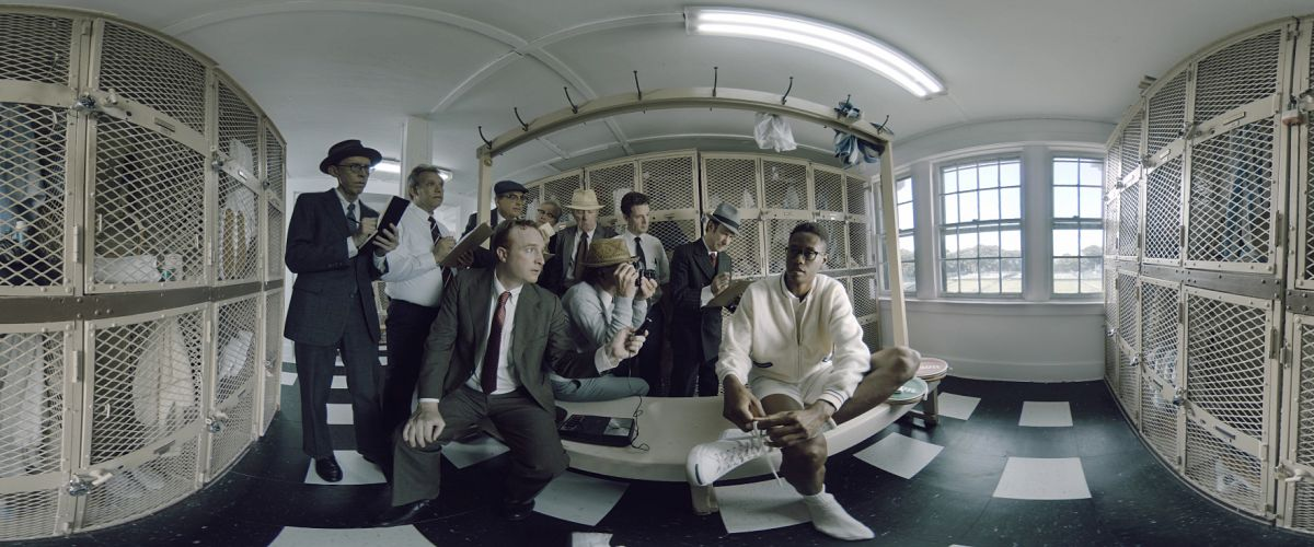"""A press scrum grills Ashe in the locker room. """"There were group screenings [of Ashe '68 at the Sundance Film Festival],"""" Cohen says, """"with a large number of headsets in sync in a single room as part of the VR cinema series. It wasn't shown to viewers one at a time — and I think communally is the best way to view immersive film, because it generates a conversation, the same way that traditional films are ideally viewed in a theater. That's where the filmmakers want you to see them. In immersive filmmaking, this is the closest we have to a version of cinema."""""""