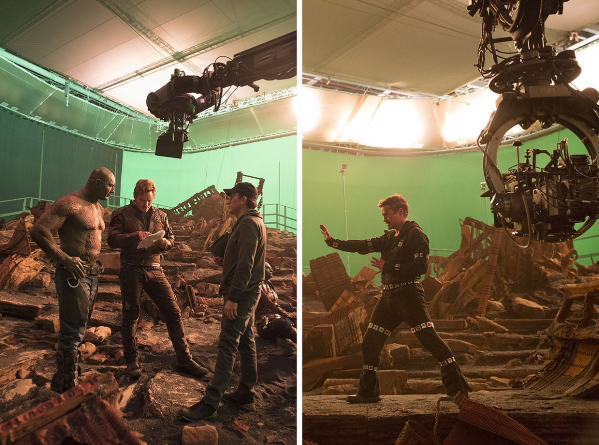 On right: Bautista and Pratt review the script with Anthony Russo. On left: The camera is at the ready for a shot of Downey.