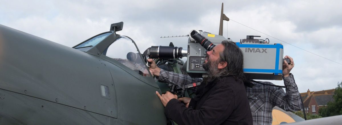With the help of a custom-made snorkel lens, Hoyte ​van Hoytema lines up an Imax camera for a POV shot aboard a replica Spitfire.​